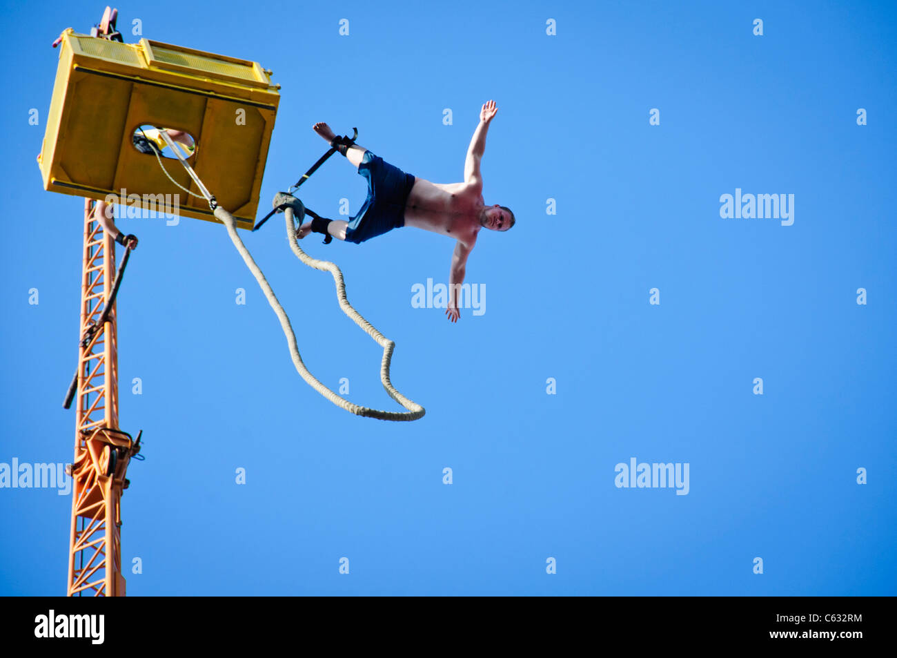 07331a61f326 young man Bungee Jumping at Woodstock festival in Kostrzyn