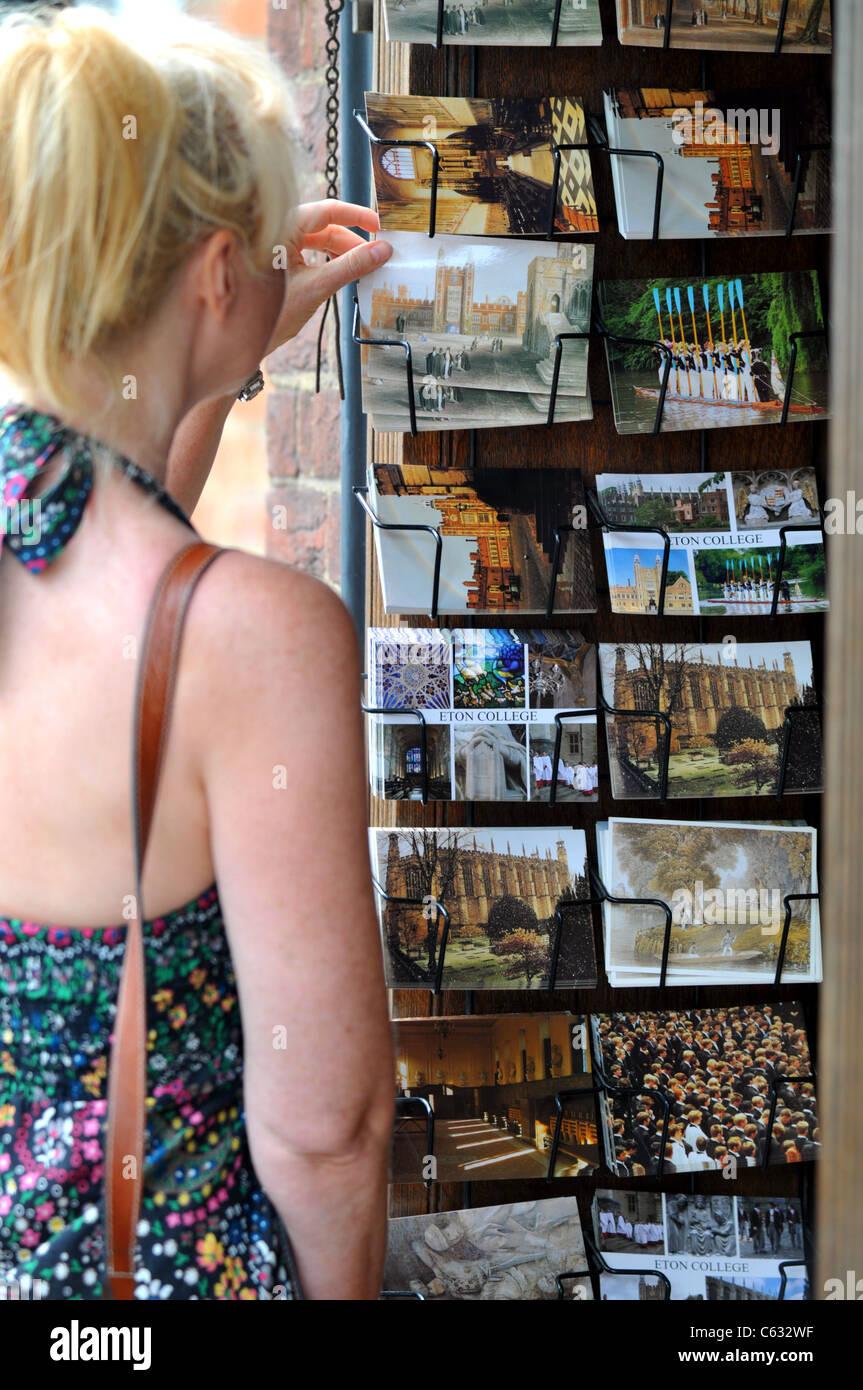 Tourist picks a postcard, Eton, Berkshire, Britain, UK - Stock Image