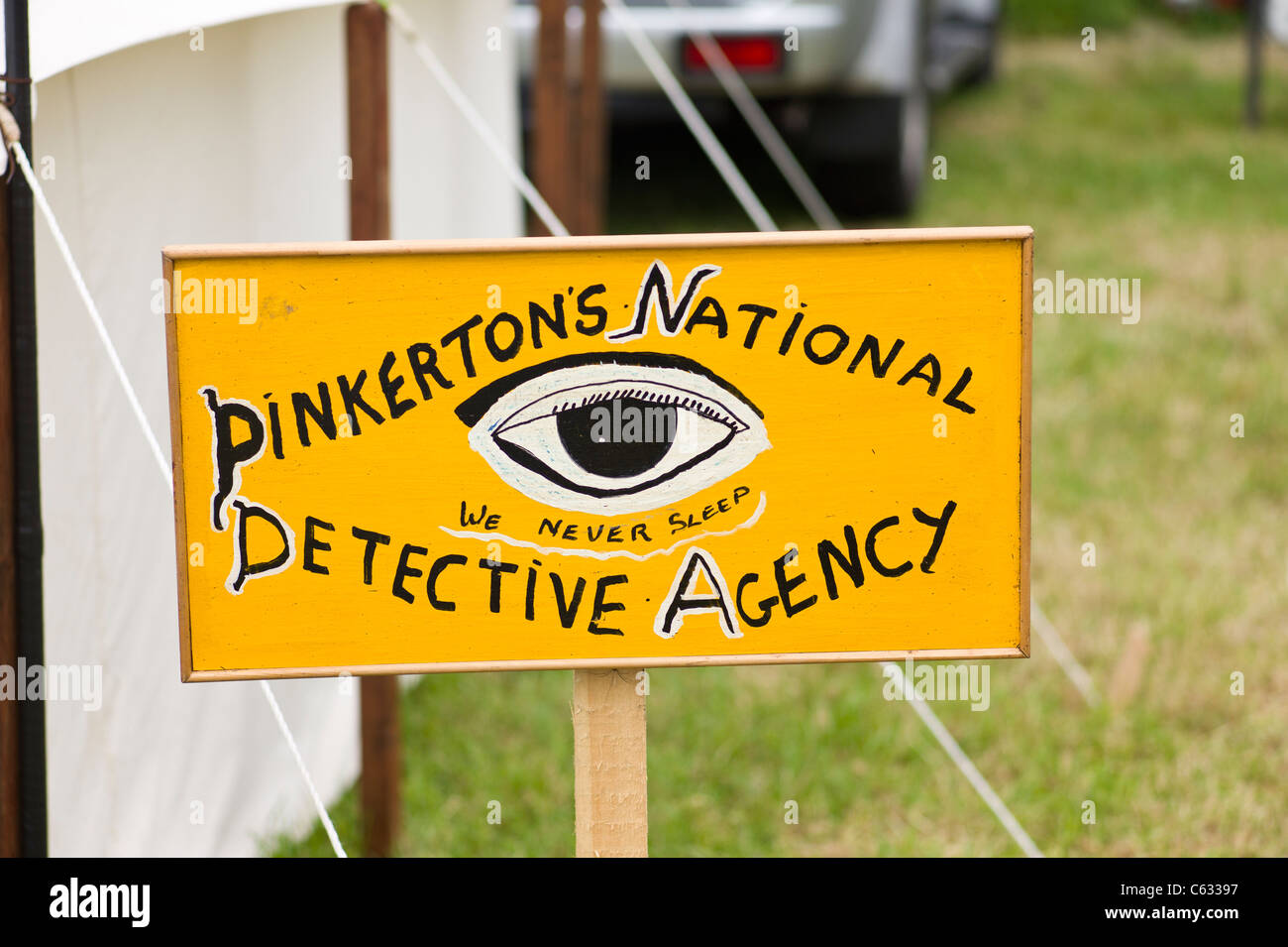 Pinkerton's National Detective Agency sign at English country event - Stock Image