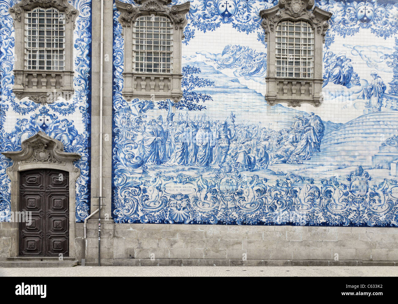 Traditional historic facade in Porto decorated with blue hand painted tin-glazed tiles, Oporto, Portugal - Stock Image