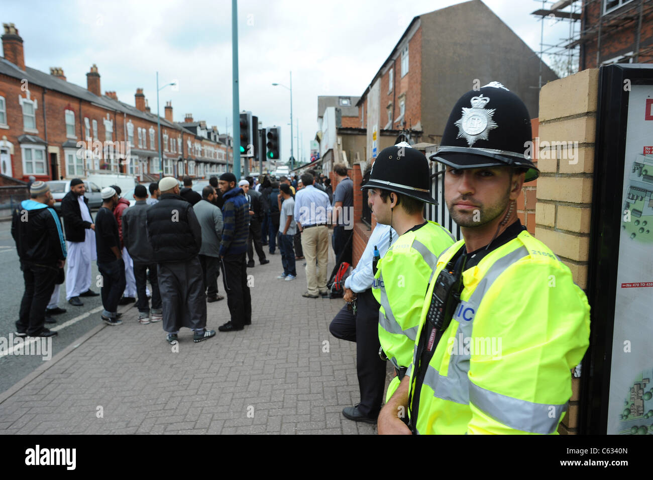 Police deployed near the Dudley Rd mosque in Birmingham's winson green area, where 3 young Asian men were killed - Stock Image