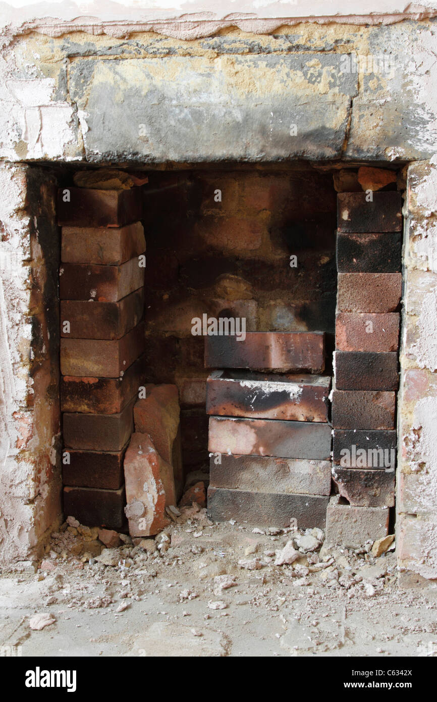 Open fire place undergoing renovation - Stock Image