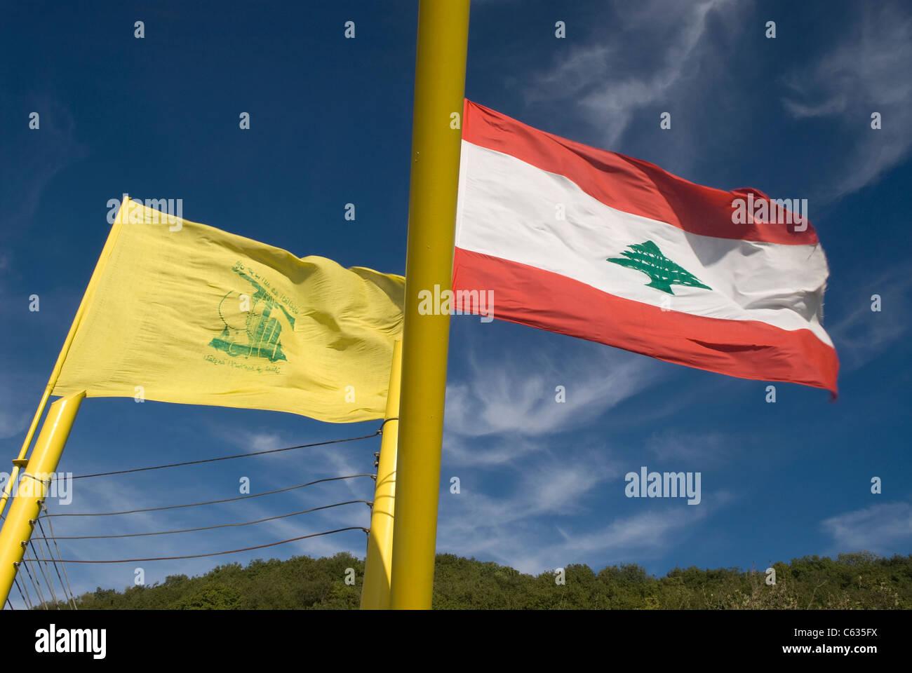Hezbollah and Lebanese national flag (right) flying over Mleeta, southern Lebanon. - Stock Image