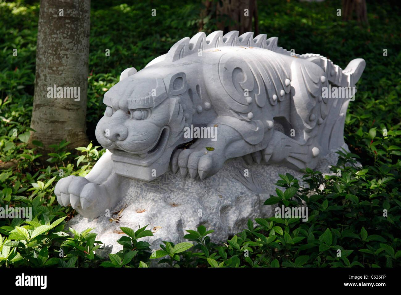 Chinese year symbol statues in Kowloon walled city park, tiger, Hong Kong, China - Stock Image