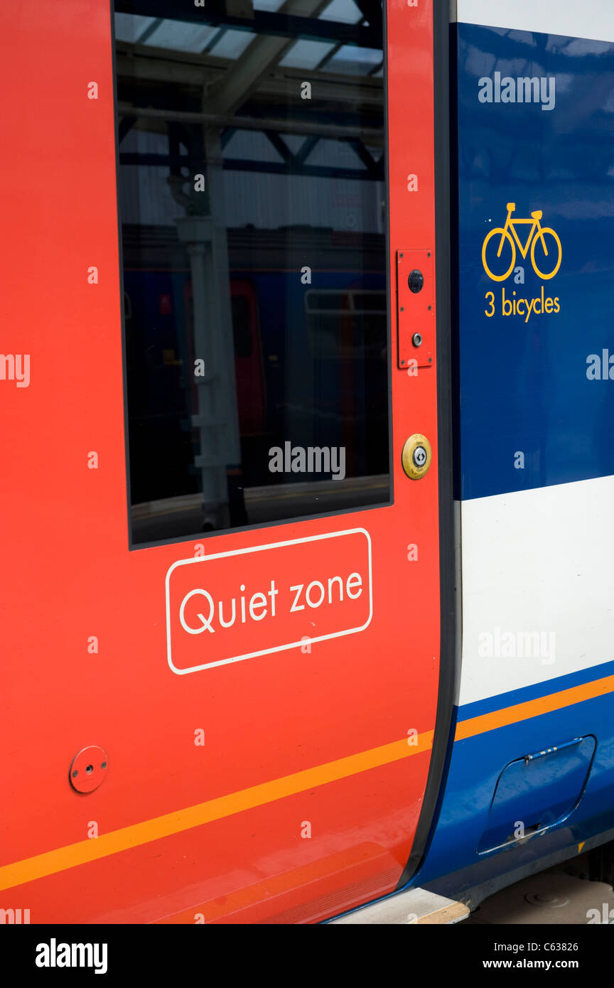 Side View of a SouthWest Trains Railway Carriage showing the quiet zone logo. - Stock Image