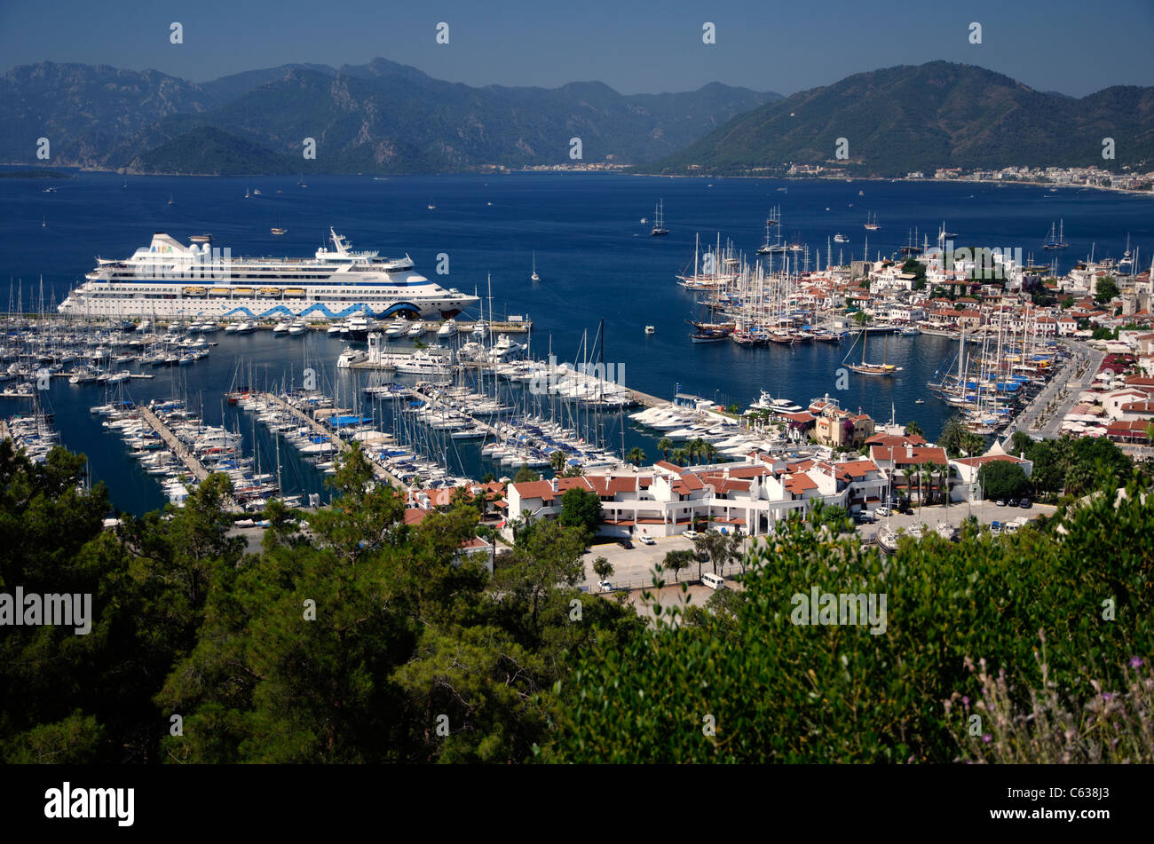 Port of Marmaris, Turkey. Old town with marina and cruise ship AIDA Aura on quay. Stock Photo