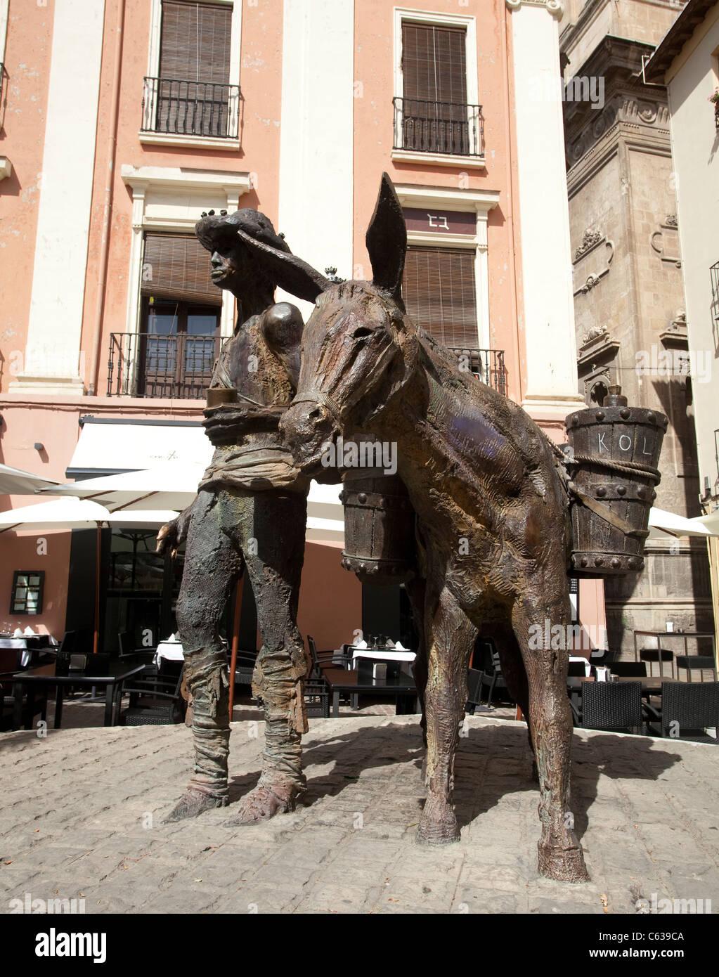 Donkey and Shepherd at Granada in Spain - Stock Image