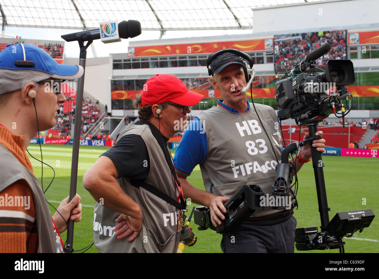 Steadicam operators and sound man wait for the teams of Japan and Mexico to take the field for a 2011 Women's - Stock Image