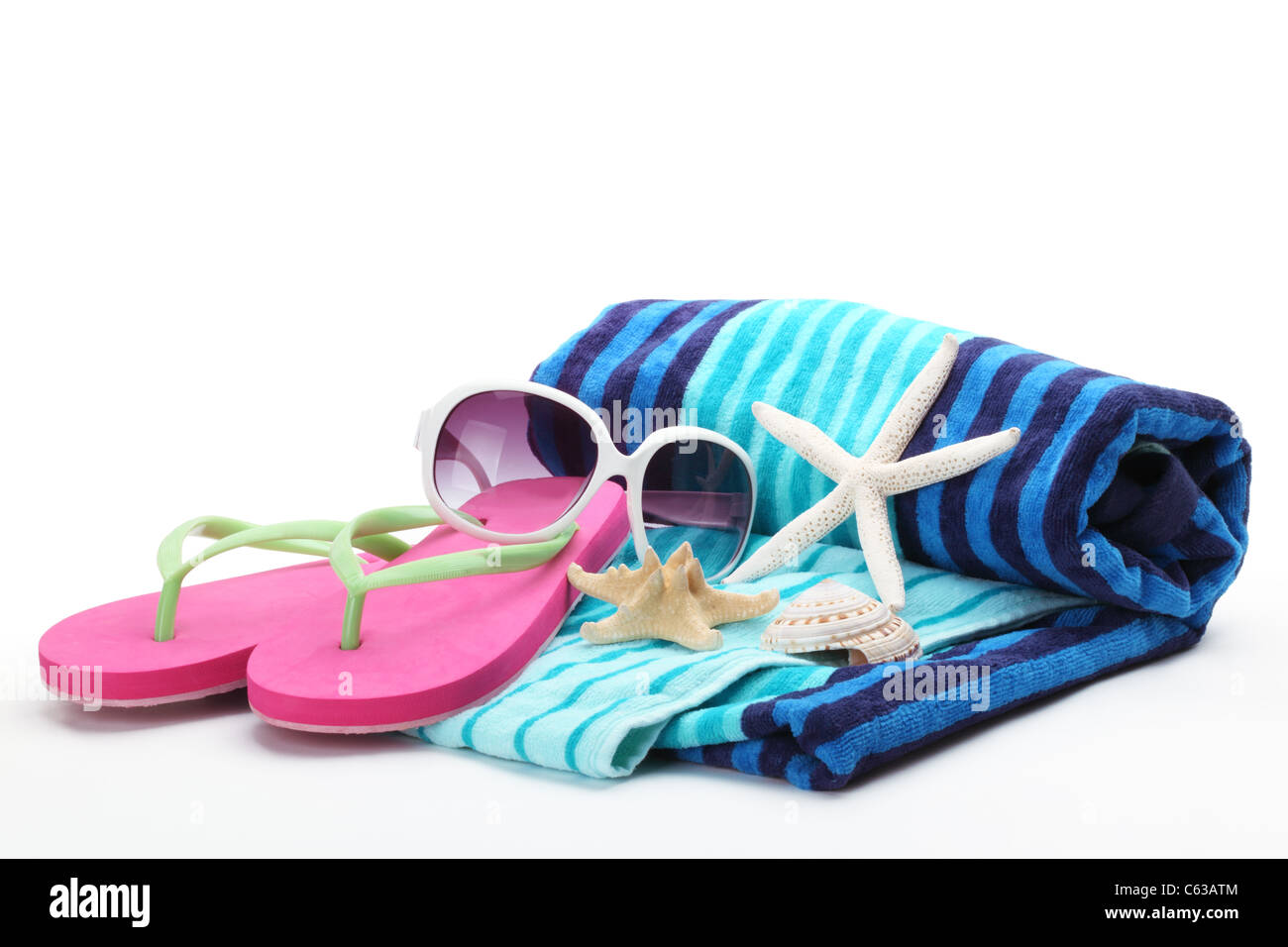 11b95536646ab9 Beach accessories with flip-flops,towel and sunglasses on white background.  - Stock