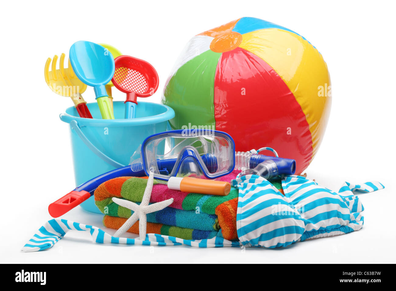 Plastic toys and diving equipment with swimming suit on white background. Stock Photo