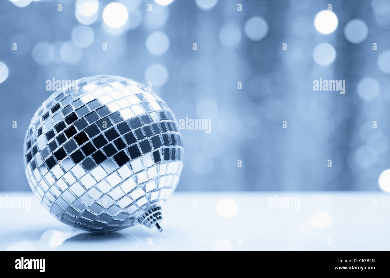 Shiny christmas ball over blurry background. Shallow Dof. - Stock Image