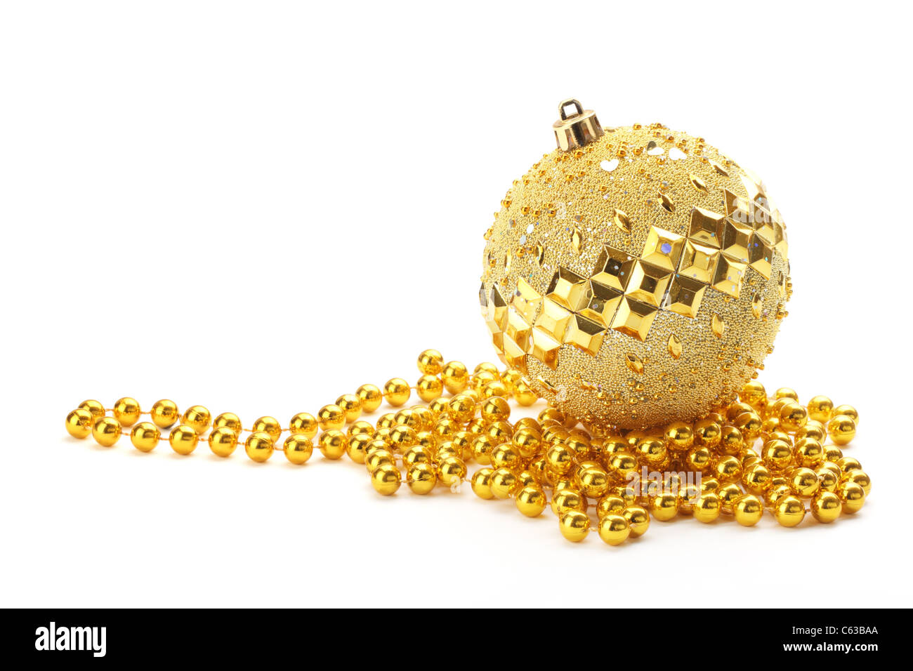 Gold Christmas ball with beads on white background - Stock Image