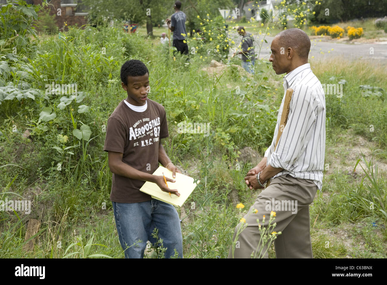 Junior High student in Detroit, MI. interviews Orland Bishop of the Shade Tree Foundation that works to motivate - Stock Image