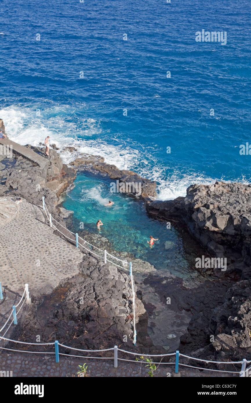 People at natural pool, San Andres, La Palma, Canary islands, Spain, Europe - Stock Image