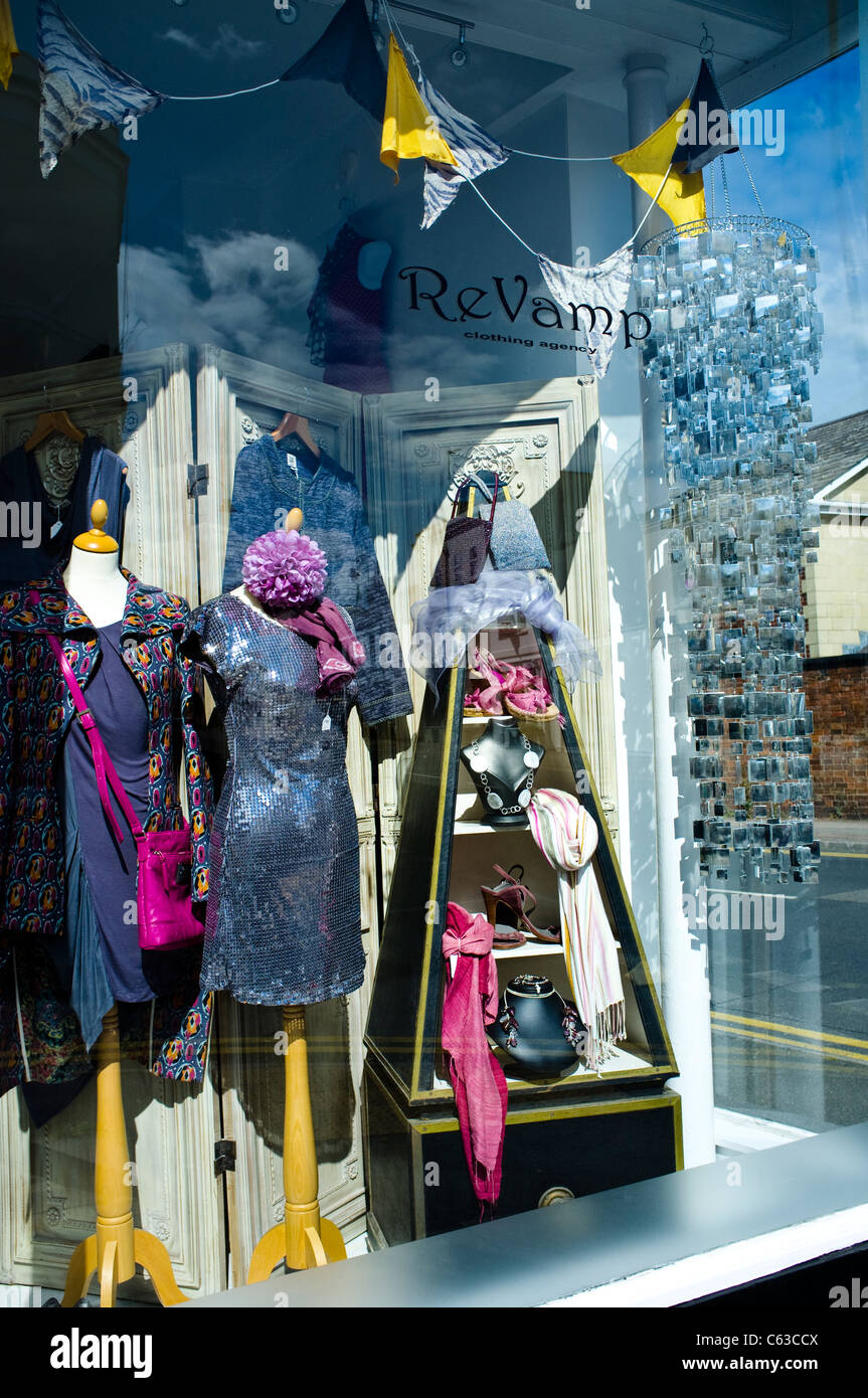 An Agency Clothing shop named ReVamp - specialising in recycling stylish second hand vintage / retro clothes. Cheltenham, - Stock Image