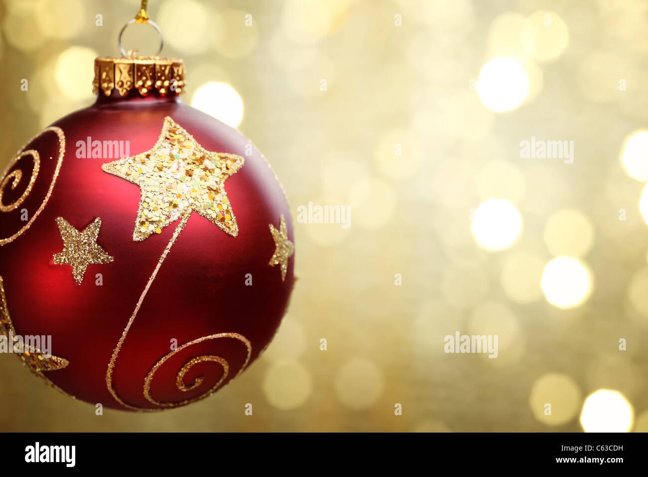 Christmas ball on abstract golden light background,Shallow Dof. - Stock Image