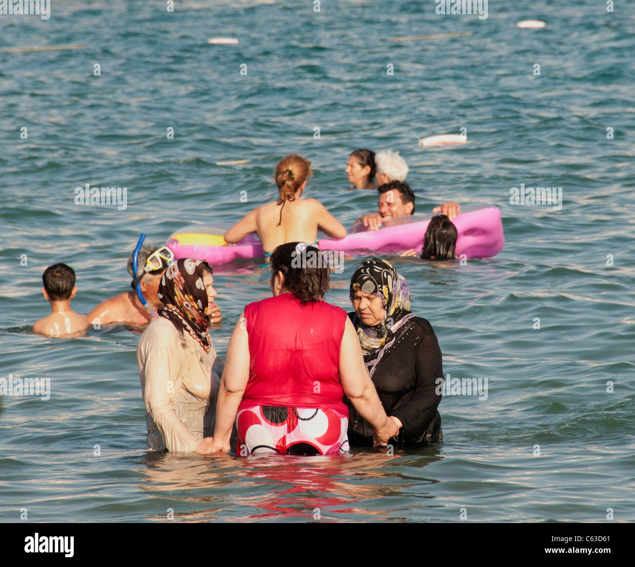 arabic muslim woman women swimming fully clothed dressed in stock