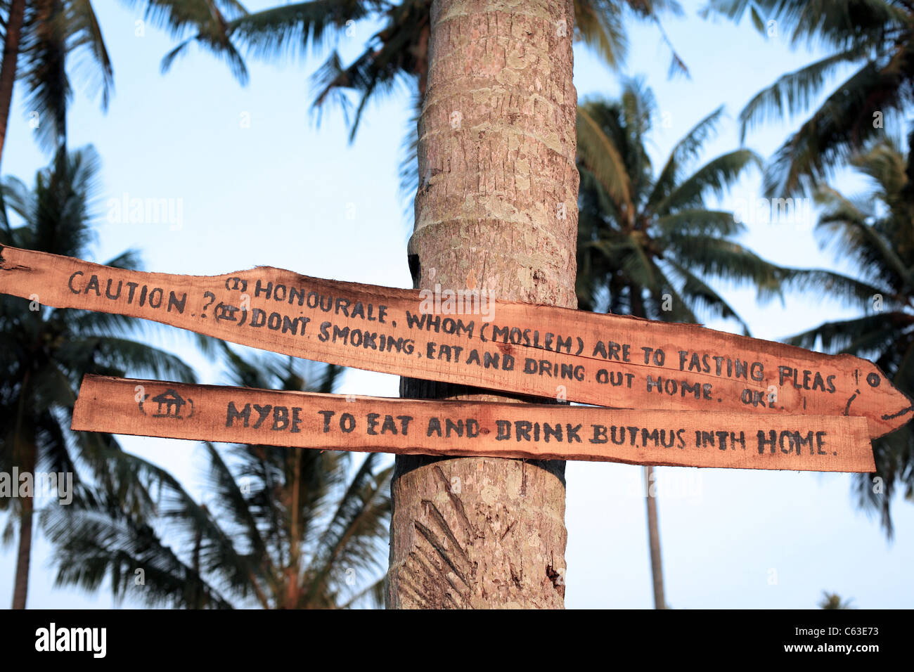 Sign at Sawarna Beach in West Java requesting respect of local Muslim customs - Stock Image