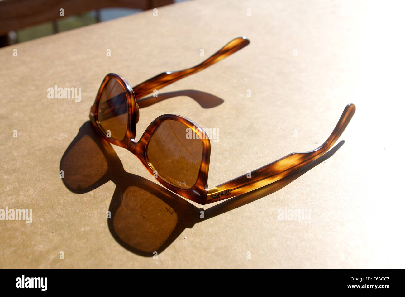Pair Of Ray Ban Wayfarers Reflecting On The Table During Happy Hour - The table happy hour