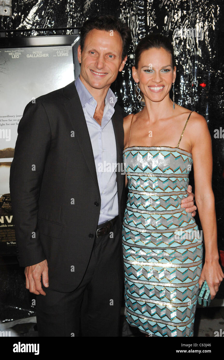 Tom Goldwyn, Hilary Swank at arrivals for CONVICTION Premiere, Samuel Goldwyn Theater at AMPAS, Beverly Hills, CA - Stock Image