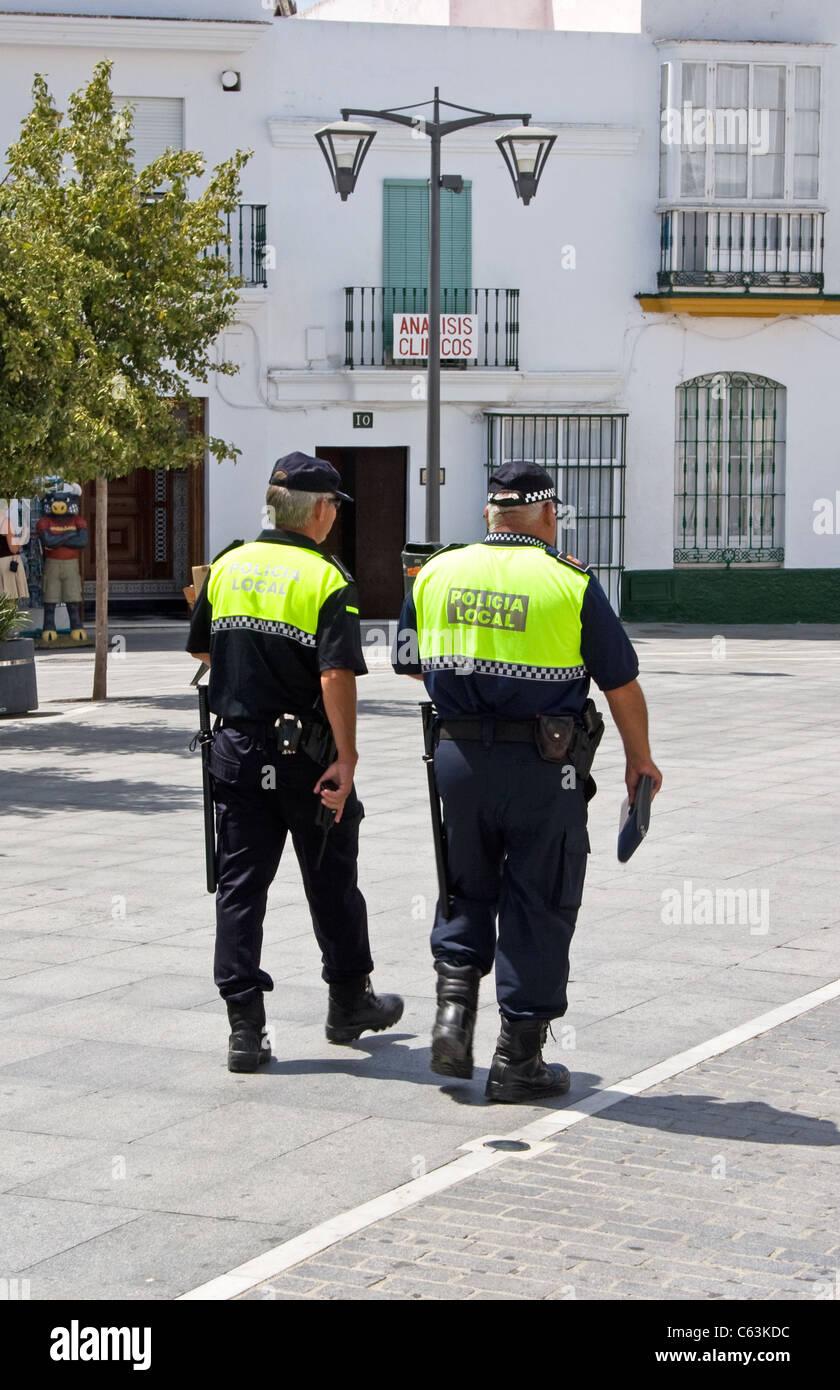 Local Police on patrol,  Plaza de Espana, town centre, Conil de la Frontera, Costa de la Luz, Andalucia , Spain - Stock Image