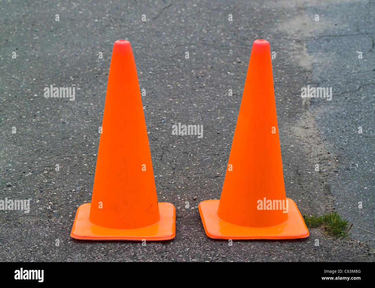 traffic cones on tarmac - Stock Image