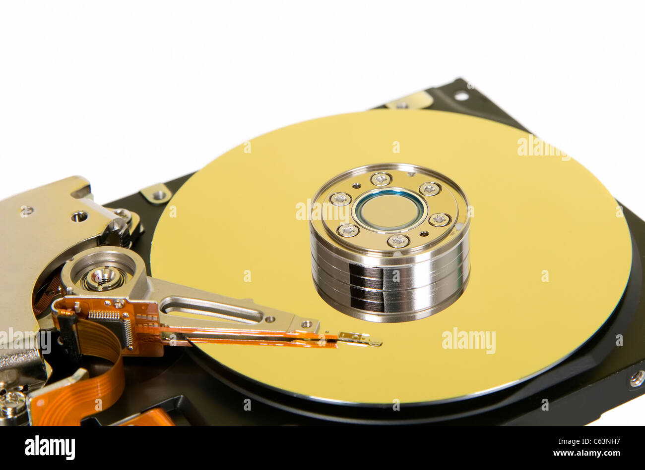 Inside of hard disc, platter with read and write head - Stock Image