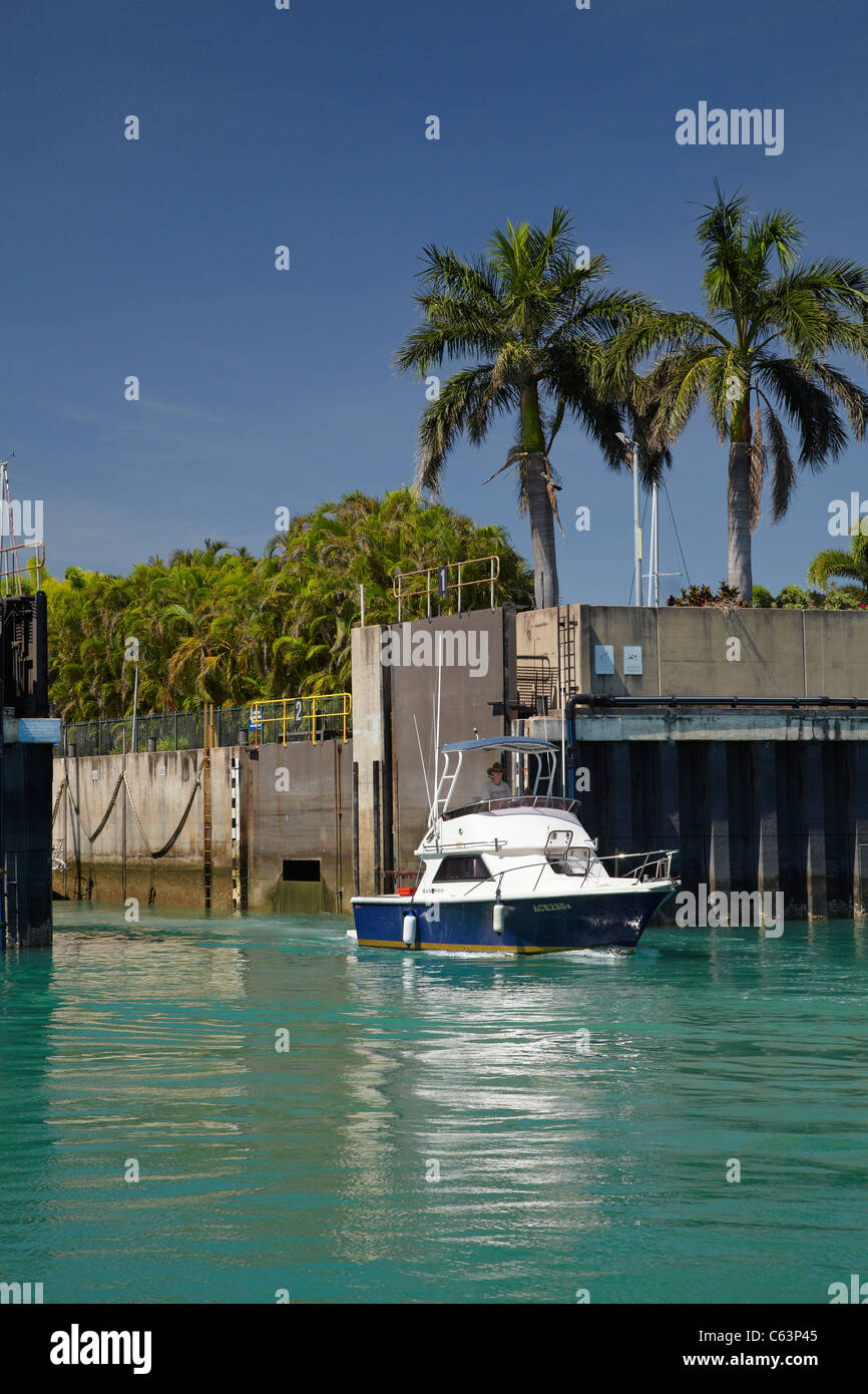 Launch exiting tidal lock, Cullen Bay Marina, Darwin, Northern Territory, Australia - Stock Image