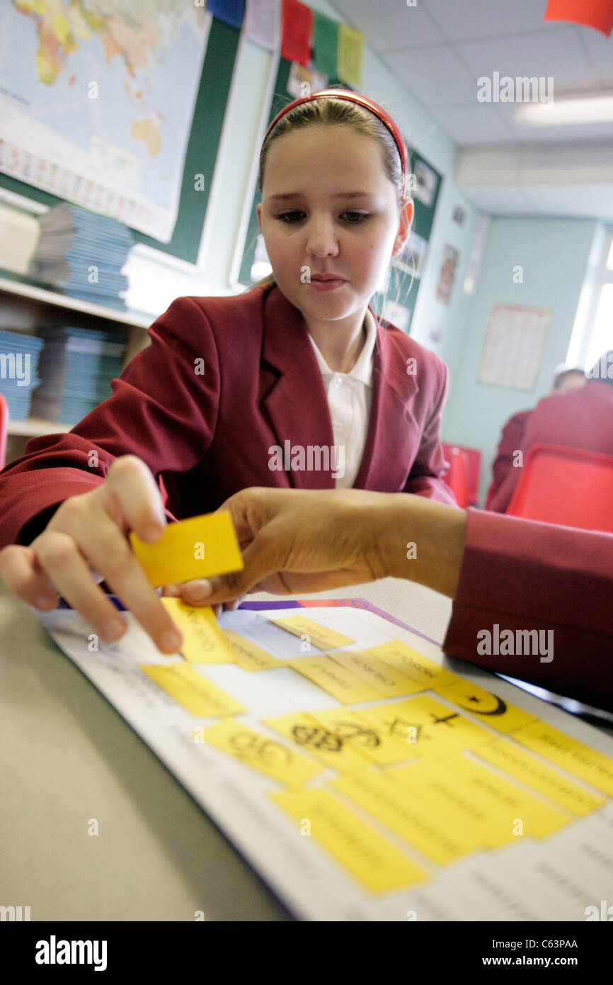A school girl taking part in a religious education lesson at a secondary school in the UK - Stock Image