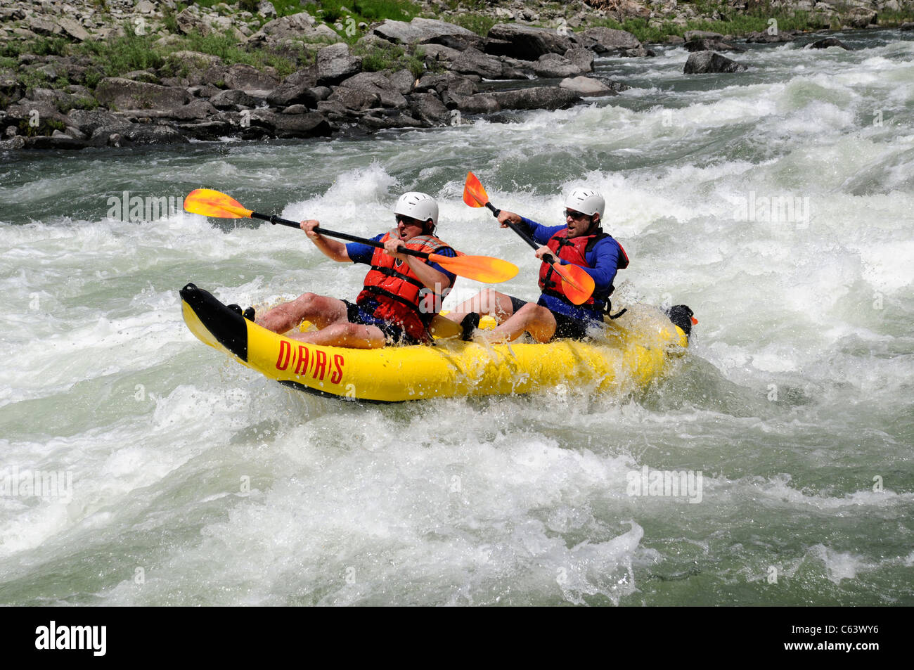 Two man inflatable kayak with O.A.R.S. in whitewater at Big Mallard Rapids on Main Salmon River in Idaho - Stock Image