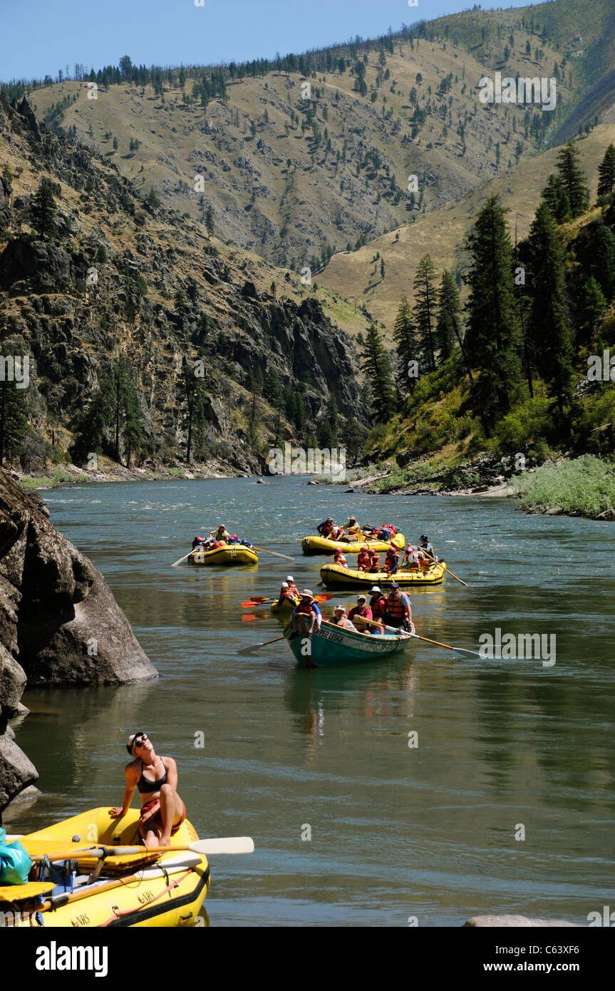 Rubber paddle boats, gear boat, dory and inflatable kayaks with the O.A.R.S. group on Main Salmon River in Idaho Stock Photo
