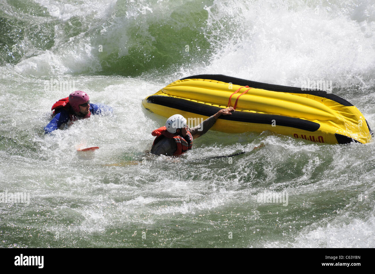 Flipping two man inflatable kayak with O.A.R.S. in whitewater at Vinegar Rapids on Main Salmon River in Idaho - Stock Image