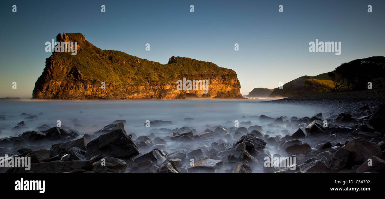 long exposure landscape with milky sea and rocks - Stock Image