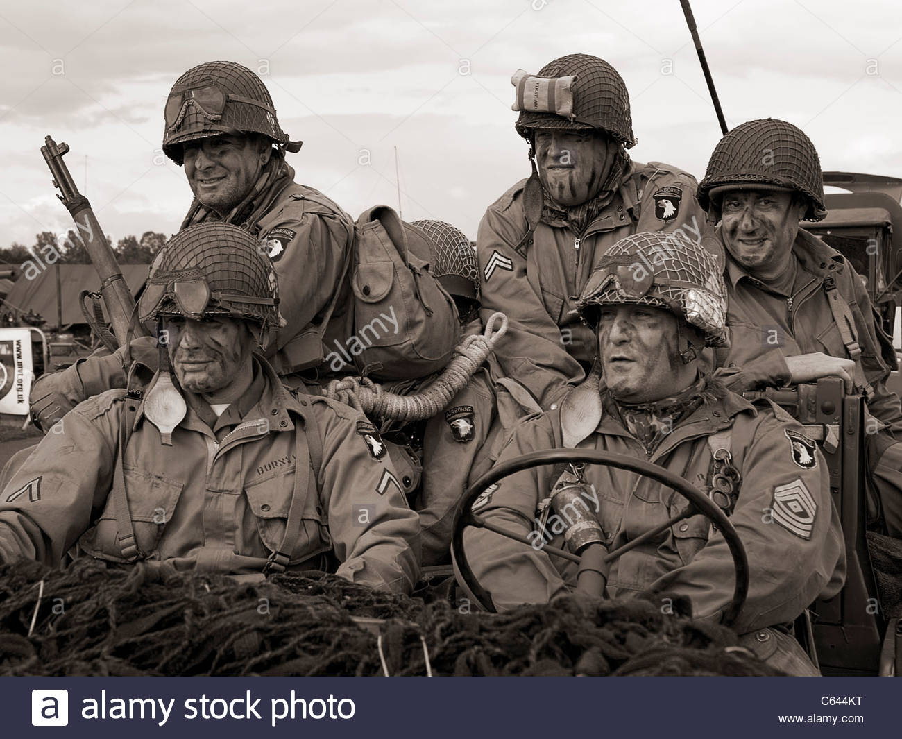 A group of men dressed in American soldier uniforms and taking part in a world war II reenactment weekend. - Stock Photo