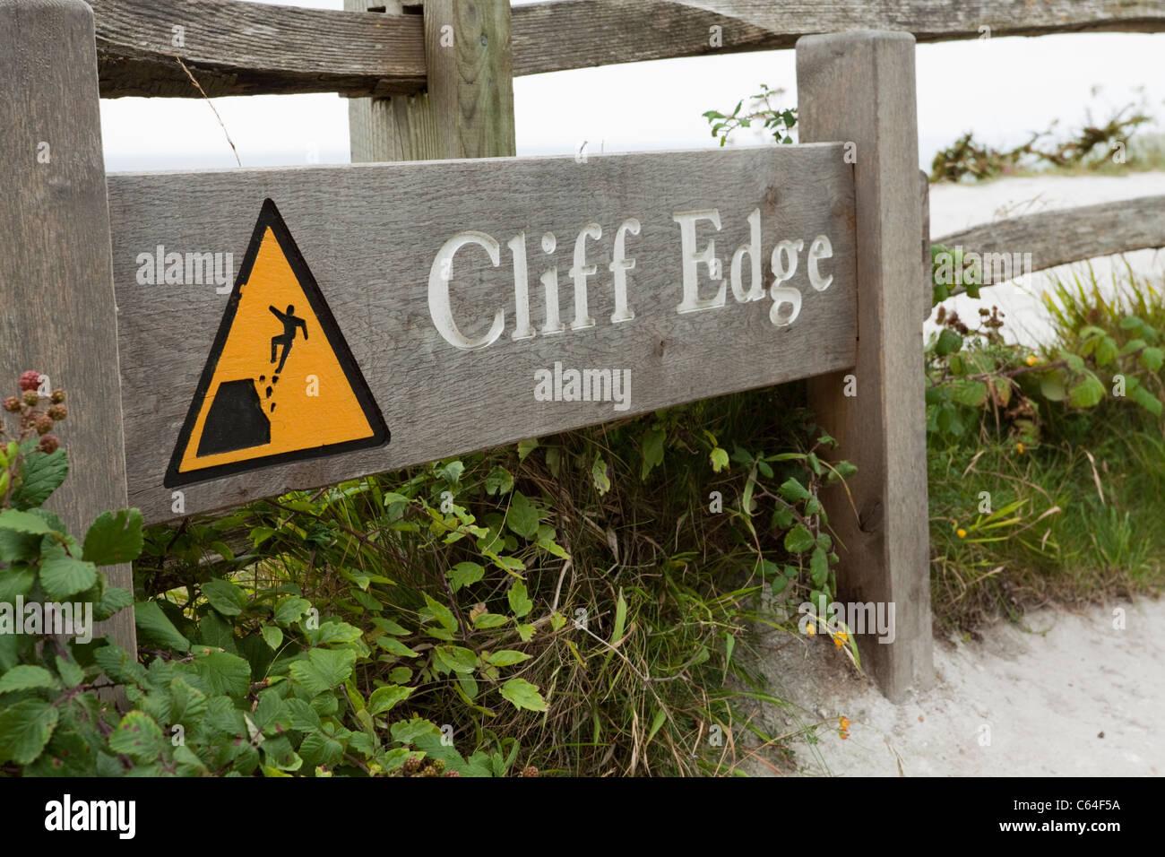 Cliff edge warning sign, Eastbourne, East Sussex, England, UK - Stock Image