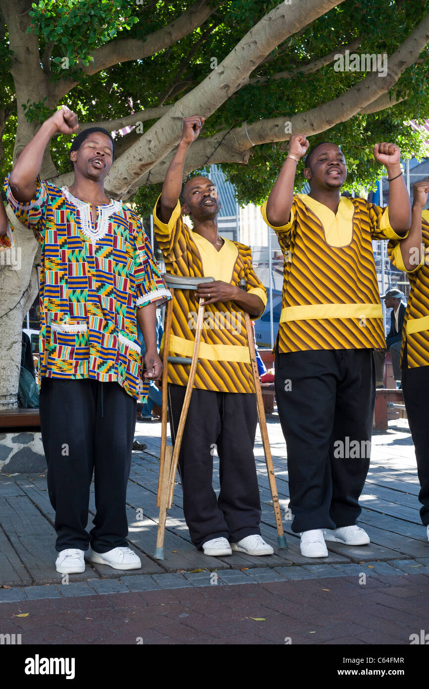 Chorus singer on crutches performing at V&A Waterfront in Cape Town South Africa Stock Photo