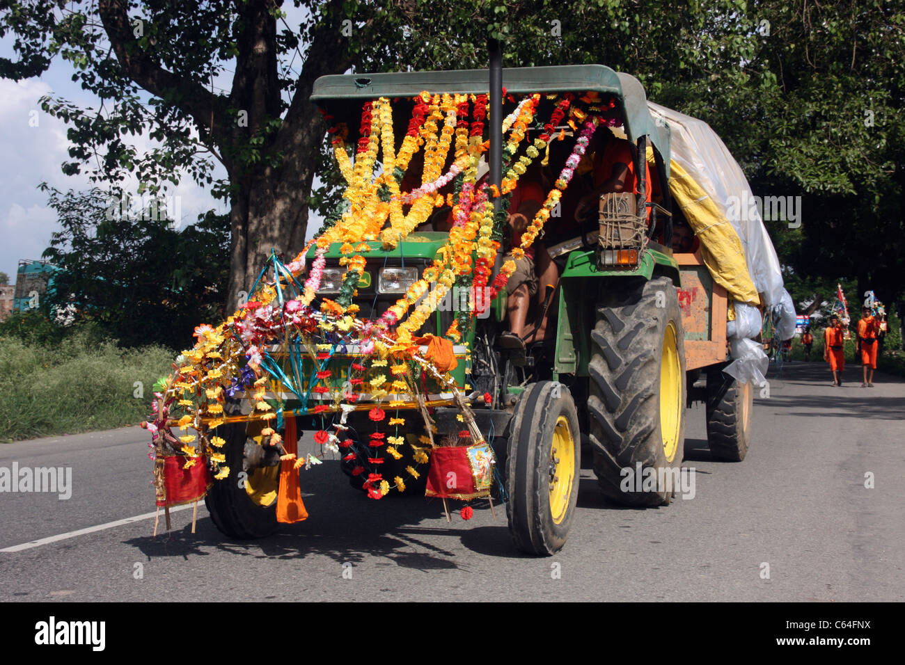 Decorated tractor leads holy procession during a religious festival in Punjab India Stock Photo