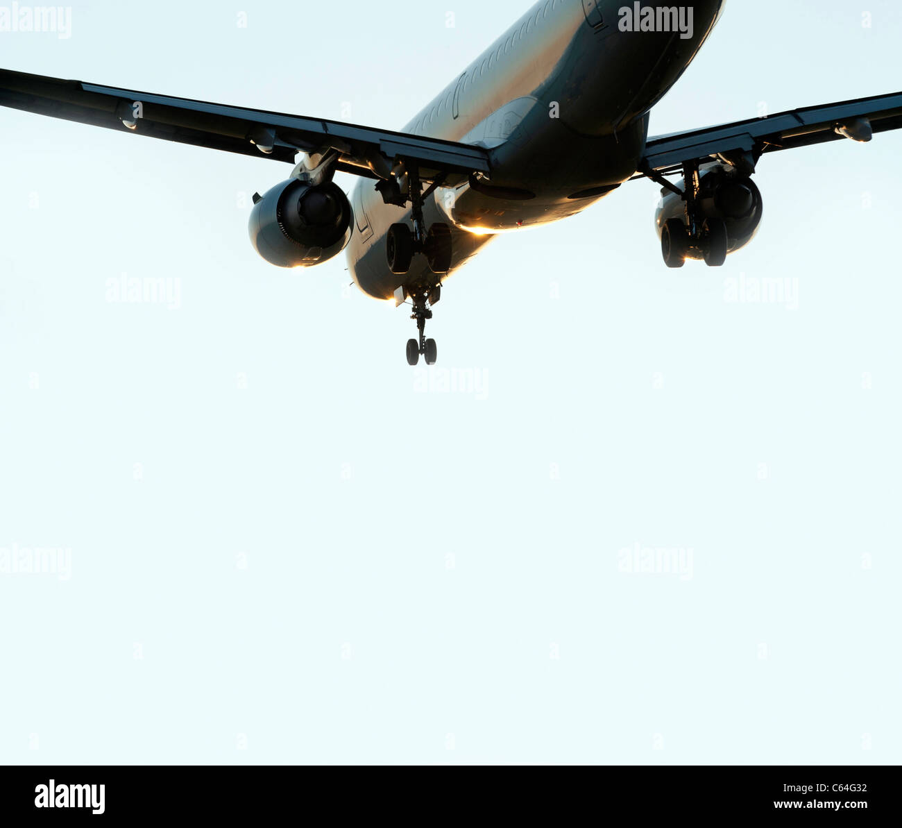 Airplane with jet engines before landing - Stock Image