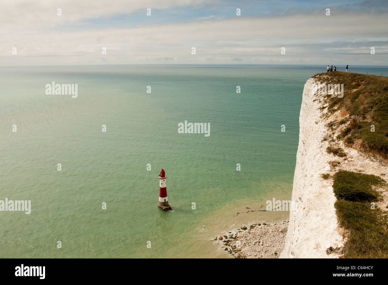 Beachy Head white cliffs and lighthouse, East Sussex, England, UK - Stock Image