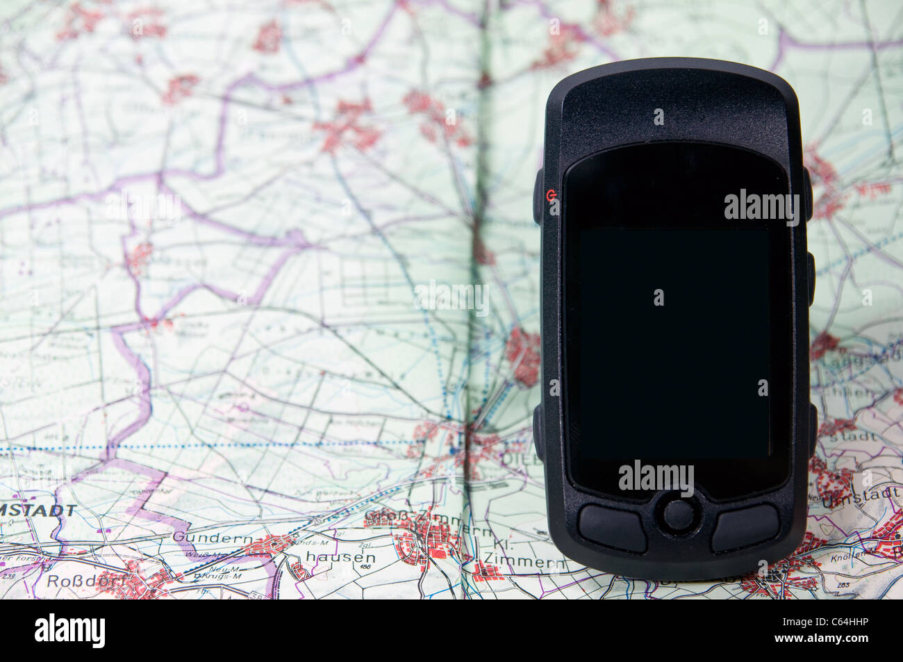 handheld gps on a route map - Stock Image