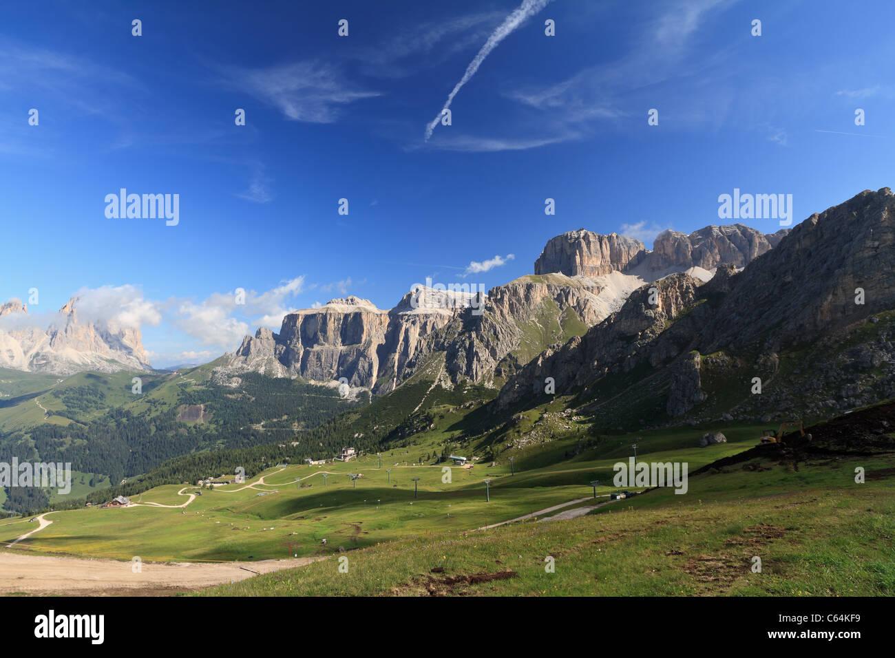 summer view of Italian Dolomites in Fassa Valley with Saas Pordoi and Sassolungo mountain - Stock Image