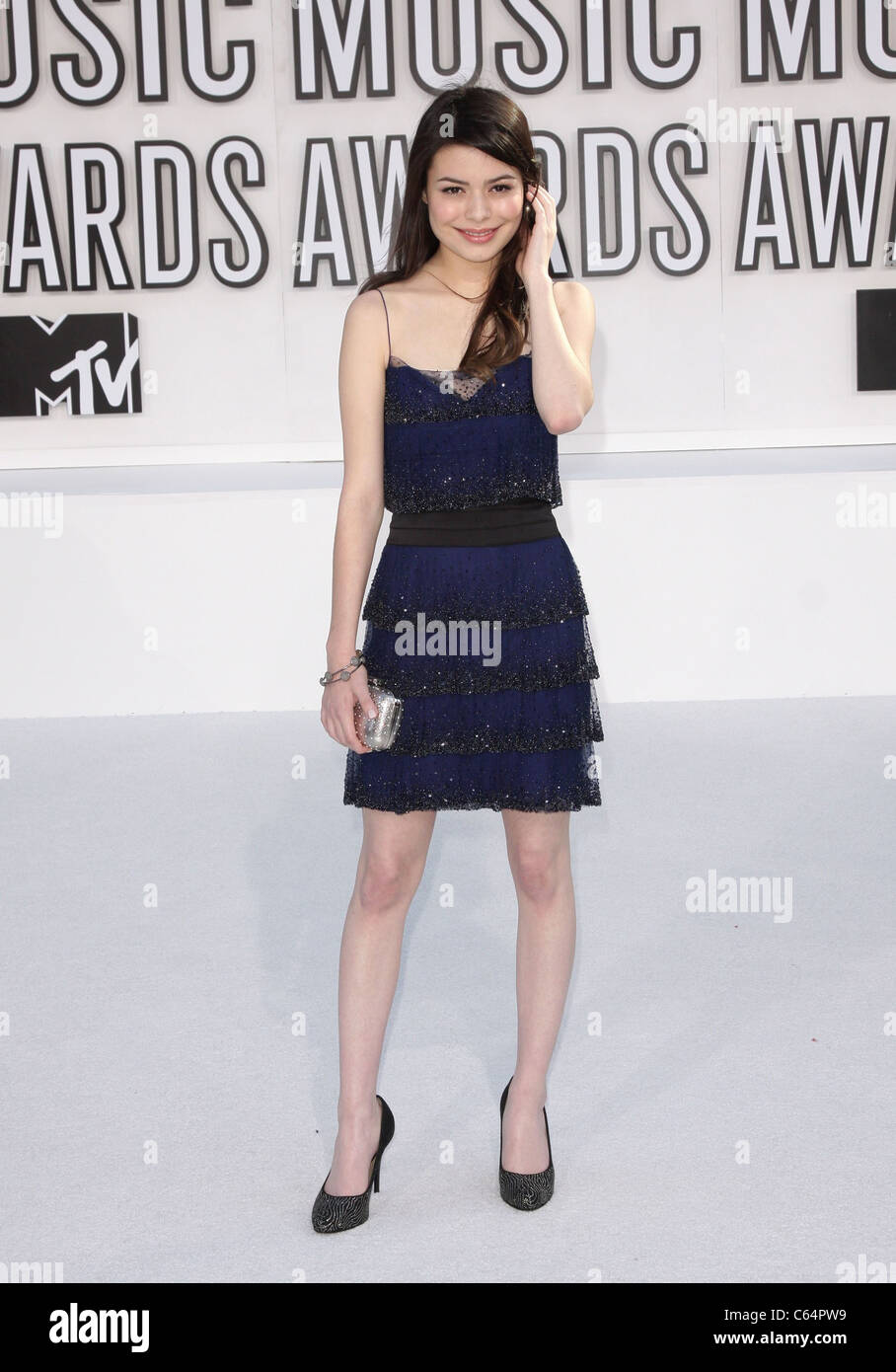 Miranda Cosgrove (wearing an Elise Overland dress) at arrivals for 2010 MTV Video Music Awards VMA's - ARRIVALS - Stock Image