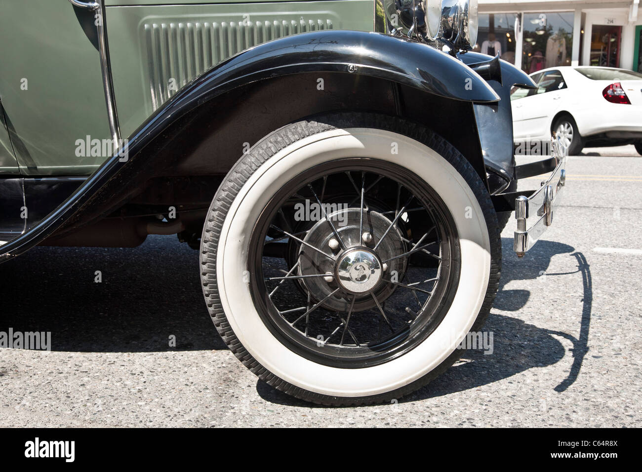 gleaming front fender & wire wheel with immaculate whitewall tire of classic Model A Ford Langley Whidbey Island - Stock Image