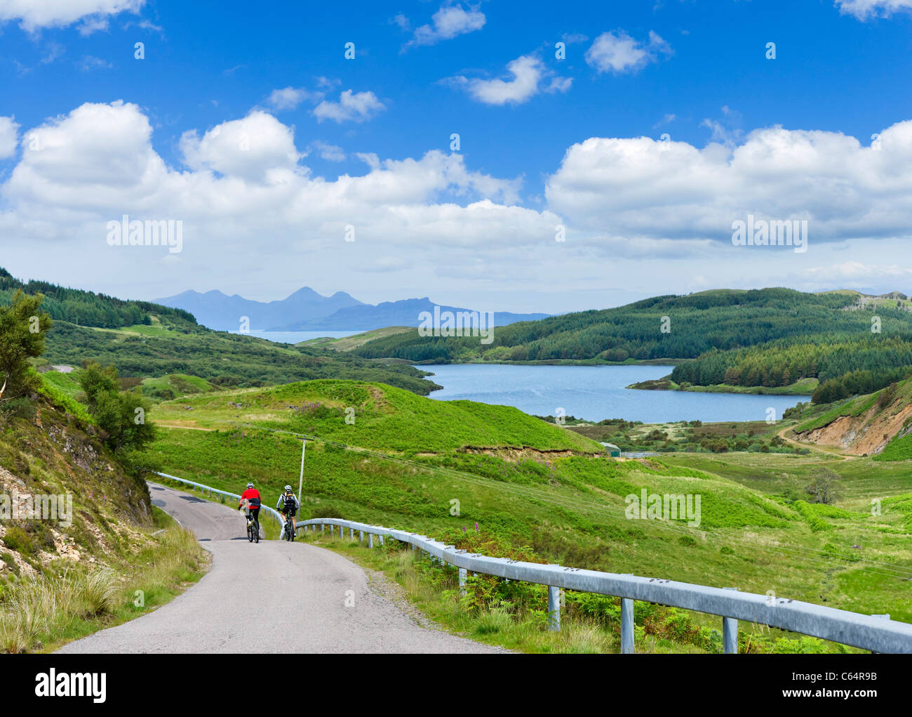 Cyclists on the road to Kilchoan on the Ardnamurchan Peninsula, Lochabar, Scottish Highlands, Scotland, UK Stock Photo