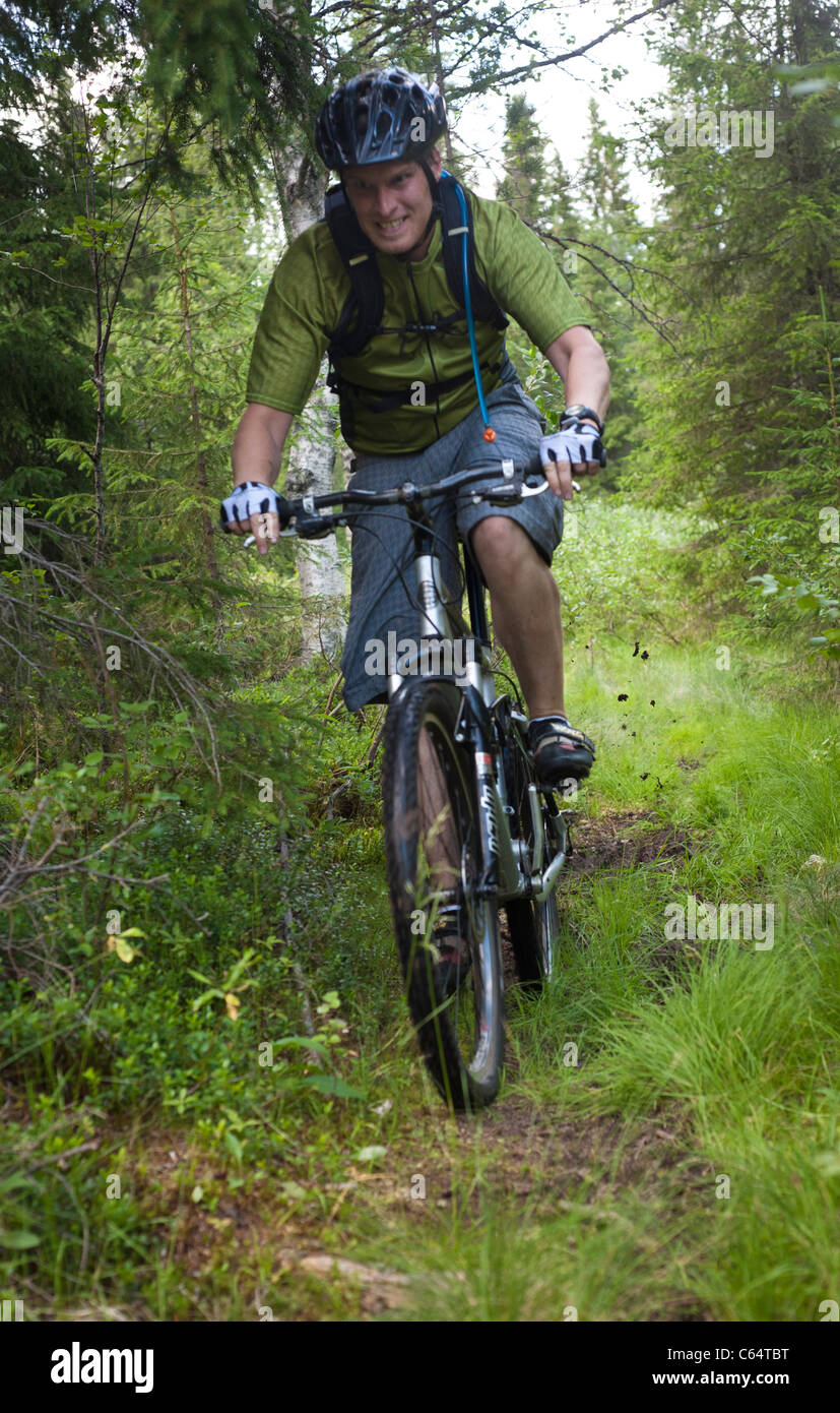 A male mountain biker riding in Isosyote, Pudasjarvi, Finland. Stock Photo