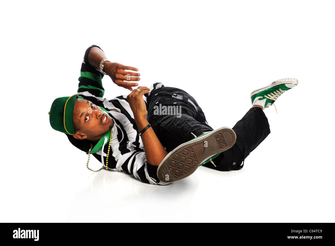 Hip hop breakdancer performing isolated over white background - Stock Image