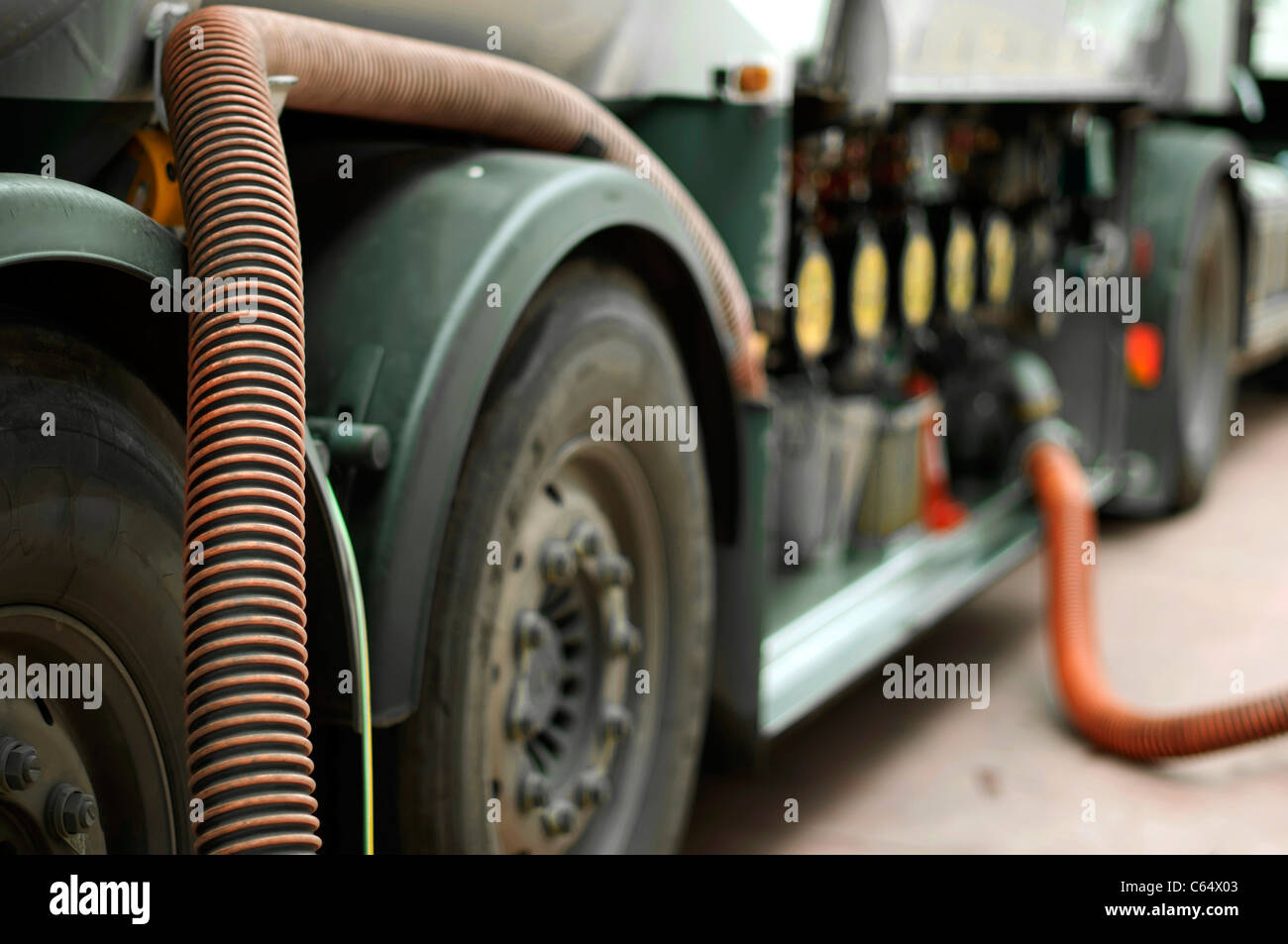 Fuel truck which refill. Hoses and pumps to load the truck - Stock Image