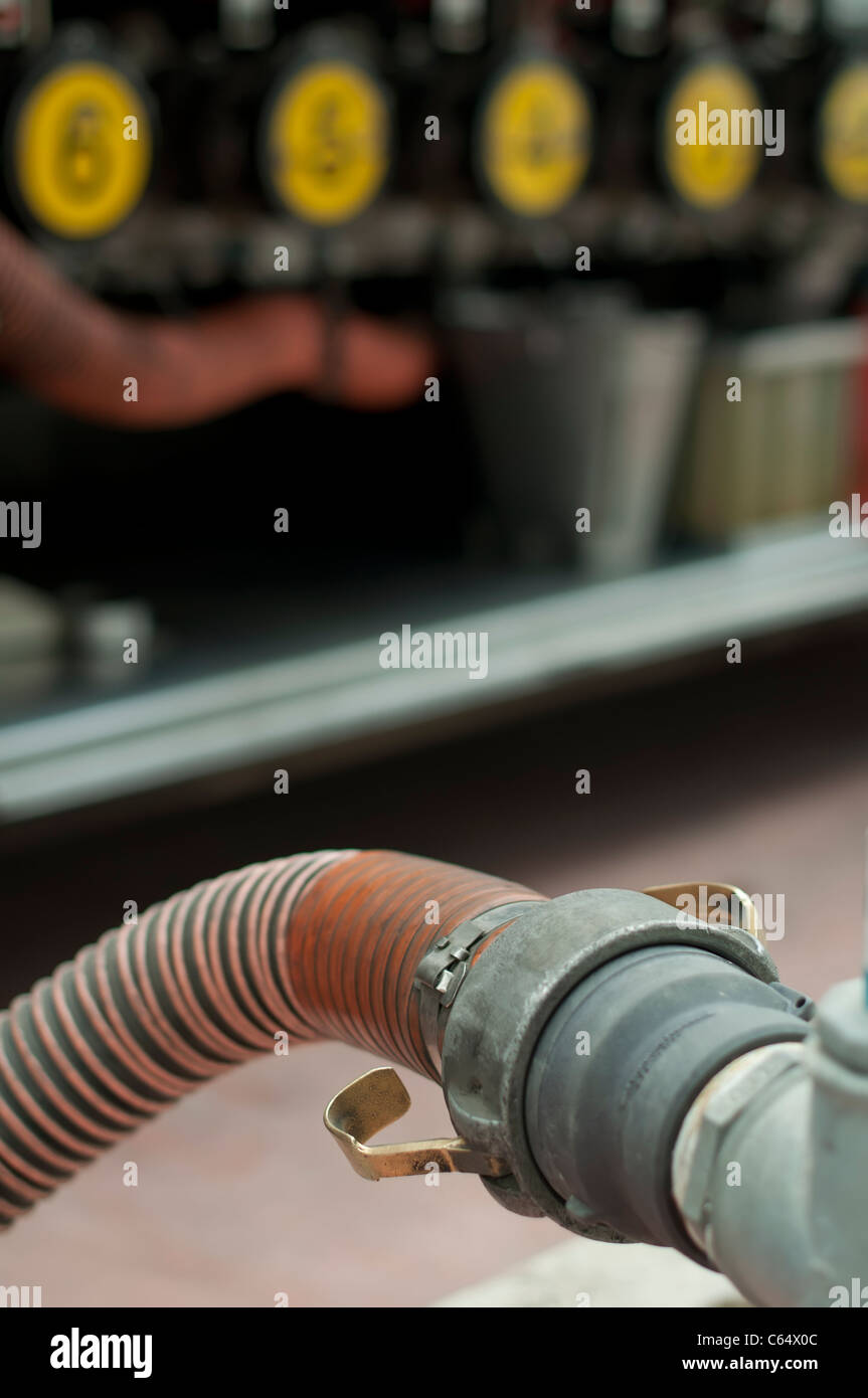 Fuel truck which refill. Hose close up and pumps to load the truck - Stock Image