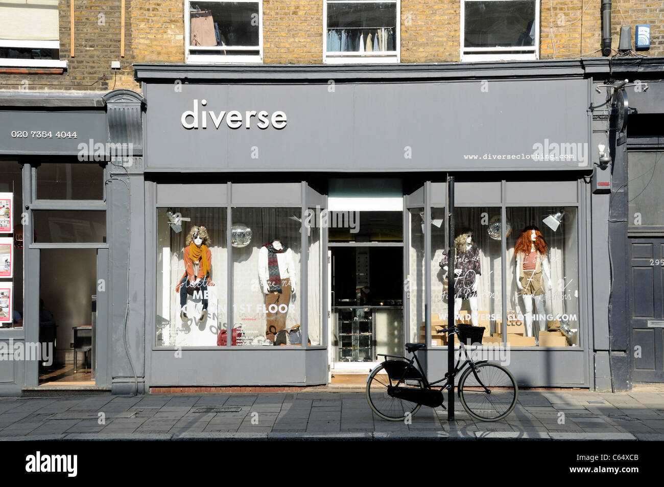 Diverse clothes shop Upper Street Islington London England UK - Stock Image
