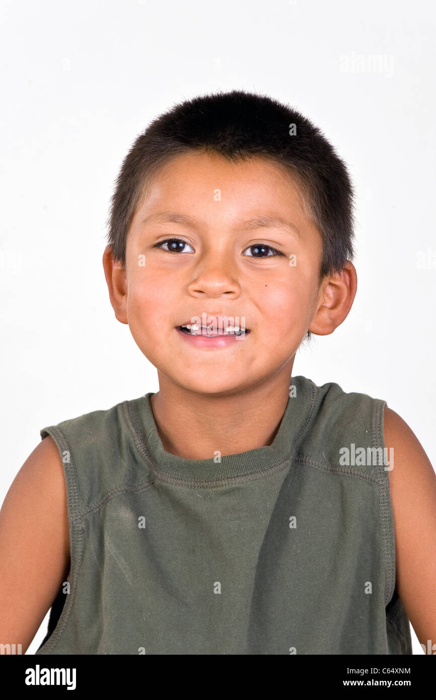 Young 6-7 year old Hispanic boy with two missing front teeth